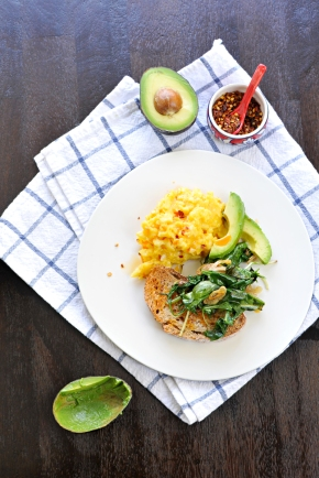 Creamy Eggs with Garlicky Greens, Avocado & Chili Oil